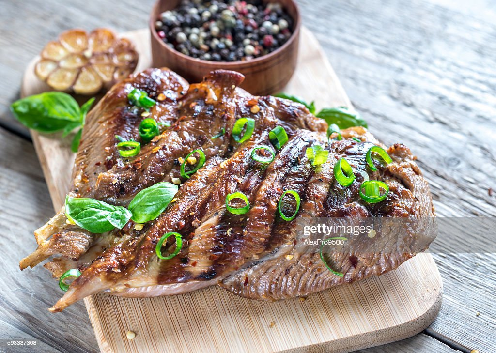 Grilled turkey with green scallion on the wooden board : Stock Photo