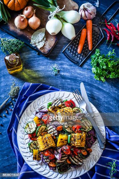Grilled vegetables plate shot from above on bluish kitchen table