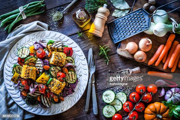 Grilled vegetables plate shot from above on rustic wooden kitchen table