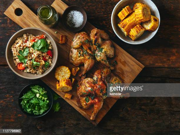 grilled whole butterflied chickens - chicken meat stock pictures, royalty-free photos & images