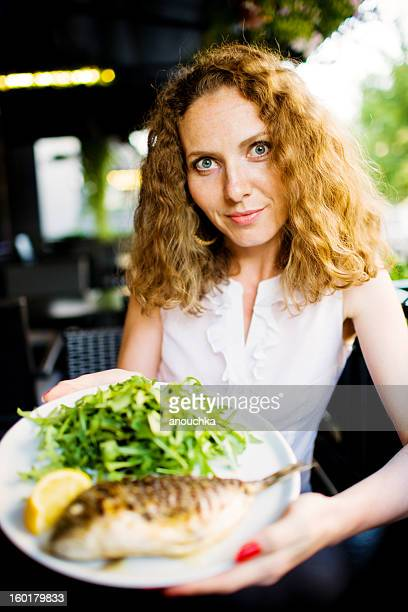 grilled whole sea bream served with rocket salad and lemon - dorado fish stock photos and pictures