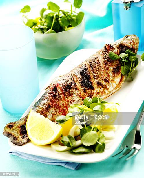 Grilled whole trout with watercress