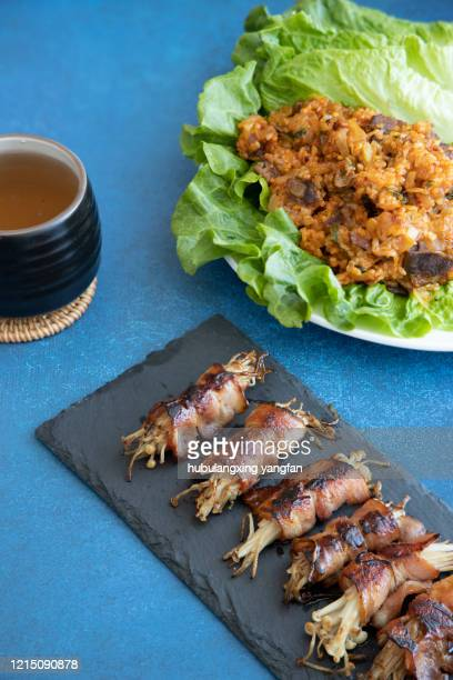 grilling bacon with enoki mushrooms - enoki mushroom stock pictures, royalty-free photos & images