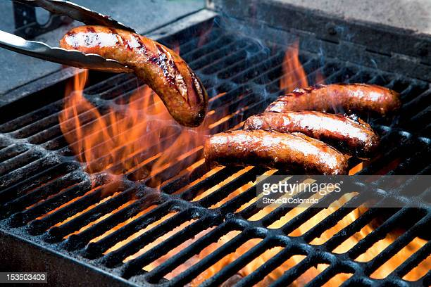 grilling 'brats - metal grate stock photos and pictures