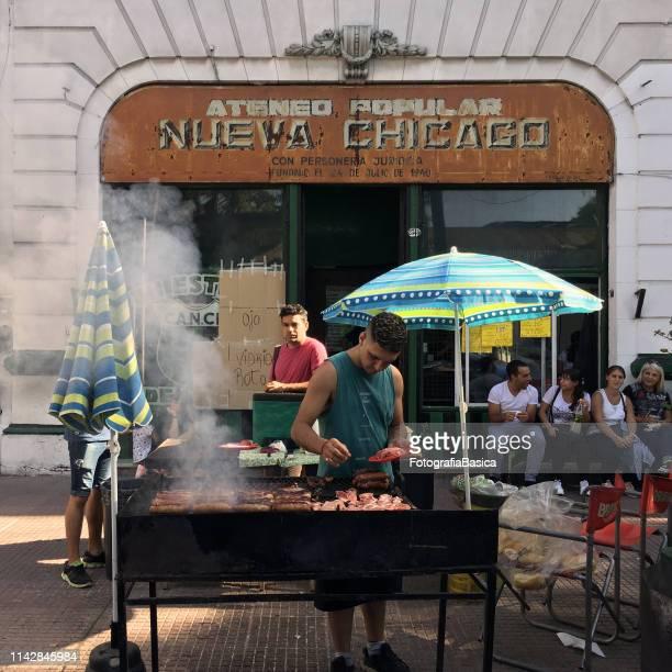 grilling chorizos and pork outdoors - carne assada imagens e fotografias de stock