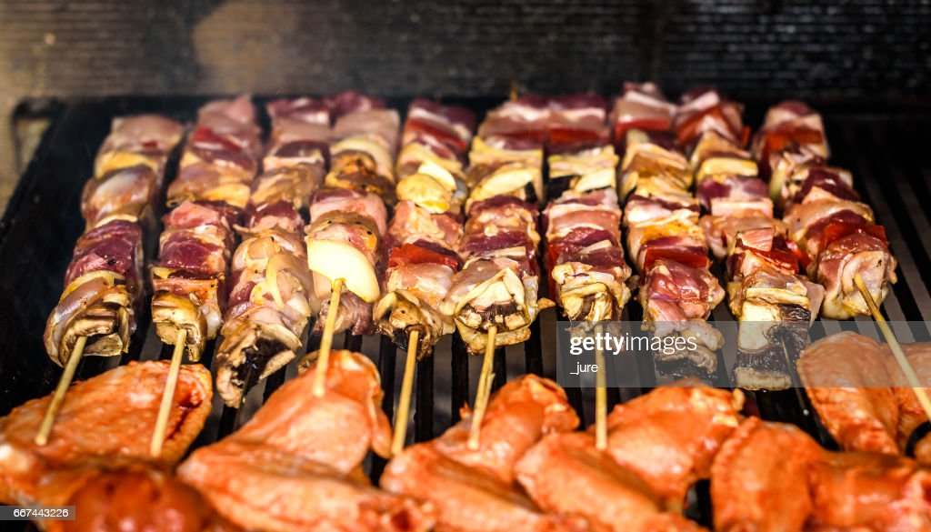 Grilling Meat Skewers And Chicken On Natural Charcoal Barbecue Grill Foto De Stock Getty Images