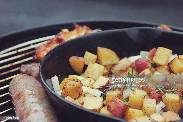 Grilling potatoes and brats