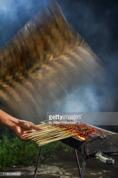 grilling sate ayam / chicken satay - yogyakarta stock pictures, royalty-free photos & images