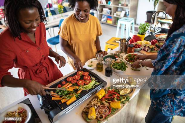 grilling vegetables in the kitchen on electrical barbecue - vegetarianism stock pictures, royalty-free photos & images