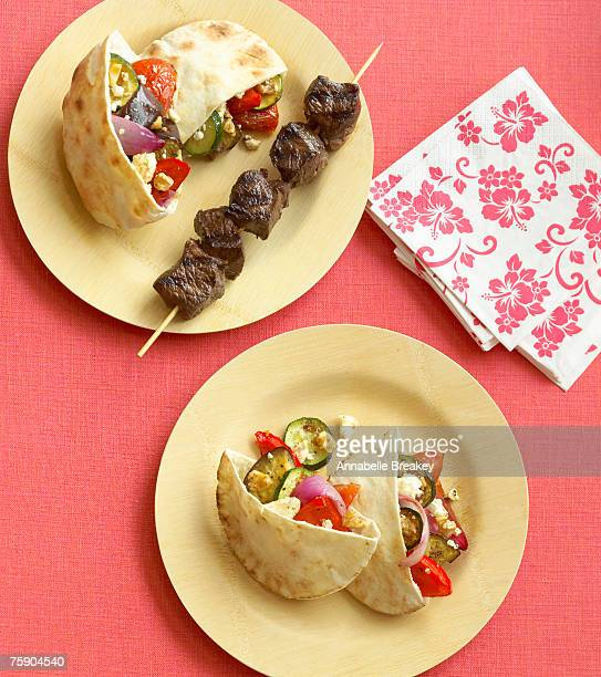 Grill-roasted vegetable pita sandwiches with grilled lamb, overhead view