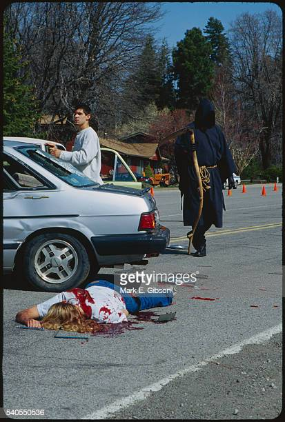 grim reaper and victims at simulated accident - gory car accident photos stock pictures, royalty-free photos & images