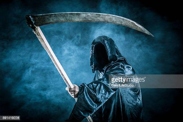 grim reaper - cape garment stock photos and pictures