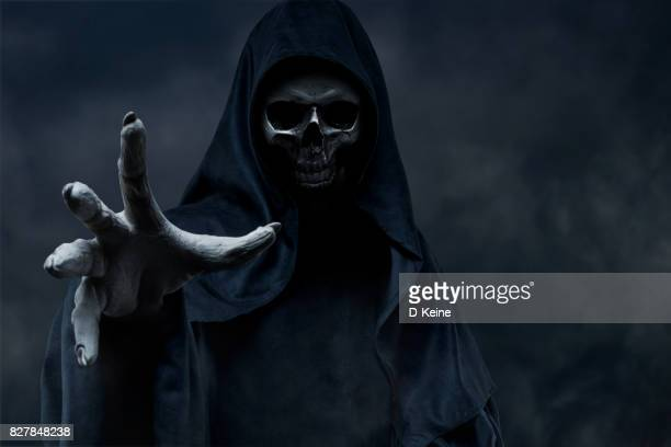 grim reaper - happy halloween stock photos and pictures