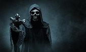 Grim reaper reaching towards the camera