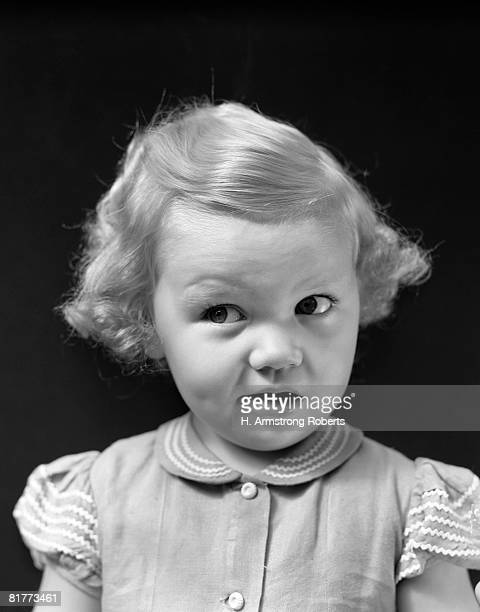Grimacing Blonde Girl With A Round Head, Big Eyes, Button Nose And Large Mouth Has A Very Dramatic Facial Expression, Looking Funny, Cute And Mischievous.