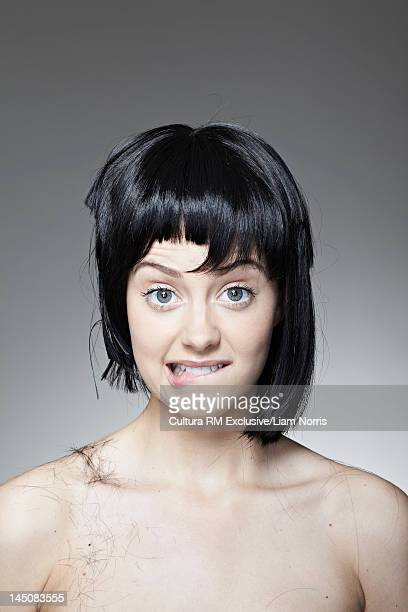 Grimacing woman with uneven haircut