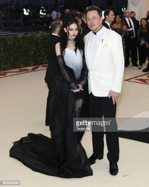 Grimes and Elon Musk attend Heavenly Bodies Fashion the Catholic Imagination the 2018 Costume Institute Benefit at Metropolitan Museum of Art on May...