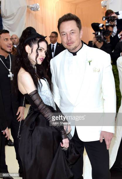 Grimes and Elon Musk attends the Heavenly Bodies Fashion The Catholic Imagination Costume Institute Gala at The Metropolitan Museum of Art on May 7...