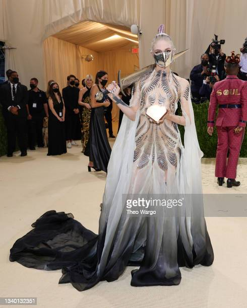 Grimes attends The 2021 Met Gala Celebrating In America: A Lexicon Of Fashion at Metropolitan Museum of Art on September 13, 2021 in New York City.