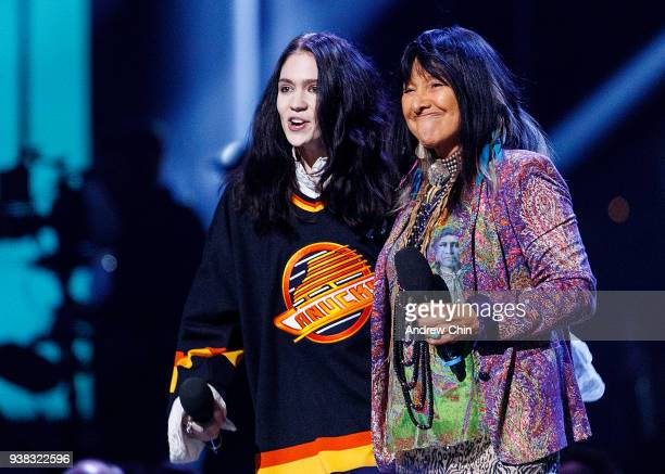 Grimes Speak and Buffy SainteMarie speaks on stage during the 2018 JUNO Awards at Rogers Arena on March 25 2018 in Vancouver Canada