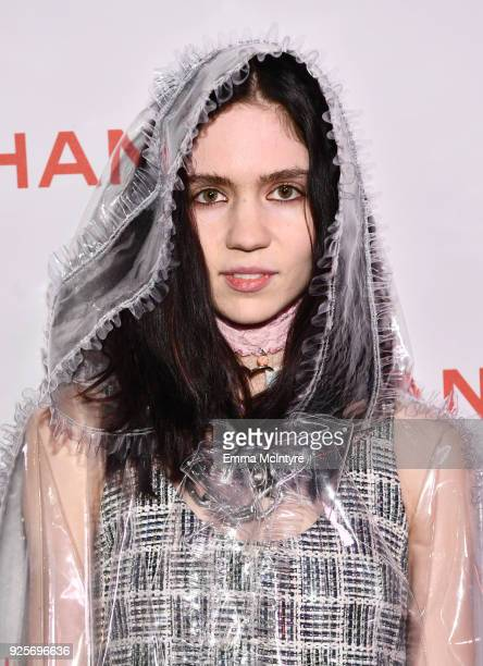 Grimes wearing Chanel attends a Chanel Party to celebrate the Chanel Beauty House and @WELOVECOCO at Chanel Beauty House on February 28 2018 in Los...