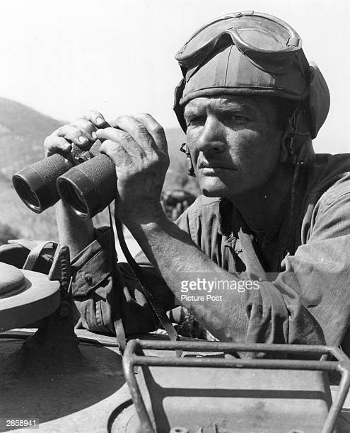 Grim-faced American tank crew commander keeping watch in Taegu, Korea. Original Publication: Picture Post - 5086 - We Follow The Road To Hell -pub....