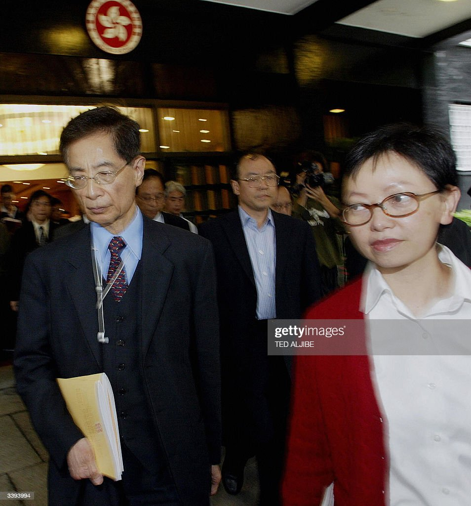 Grim-faced former Democratic Party chair : News Photo