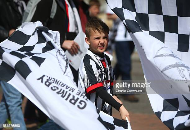 Grimsby fans make their way to the stadium ahead of the Vanarama Football Conference League Play Off Final between Forest Green Rovers and Grimsby...