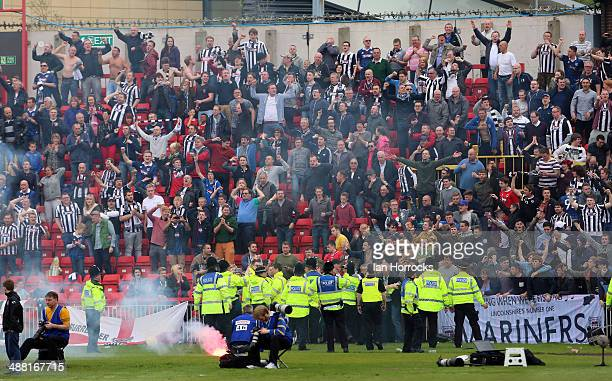 Grimsby fans set off flares after Craig Disley scored their only goal during the Skrill Conference Premier Play Offs Semi Final second leg match...
