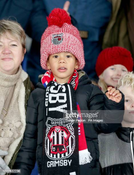 A Grimsby Town fan showing their support from the stands during the Emirates FA Cup third round match at Selhurst Park London