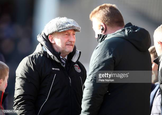 Grimsby Town manager Ian Holloway talks to Northampton Town coach Ronnie Jepson prior to the Sky Bet League Two match between Grimsby Town and...