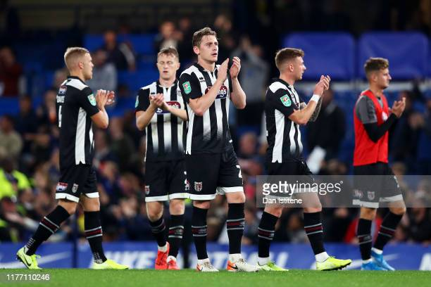 Grimsby Town players applaud the fans after the Carabao Cup Third Round match between Chelsea FC and Grimsby Town at Stamford Bridge on September 25,...