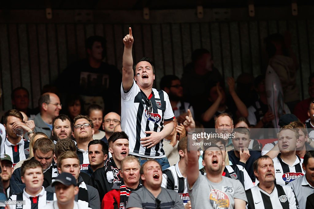 A Grimsby Town supporter sings prior to the FA Trophy Final match between Grimsby Town FC v FC Halifax Town at Wembley Stadium on May 22, 2016 in London, England.