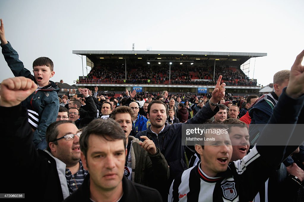 Grimsby Town supporters celebrate their teams win after the Vanarama Football Conference League match between Grimsby Town and Eastleigh FC at Blundell Park on May 3, 2015 in Grimsby, England.