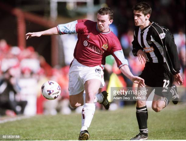 Grimsby Town's Danny Butterfield chases after Burnley's Ian Moore for the ball
