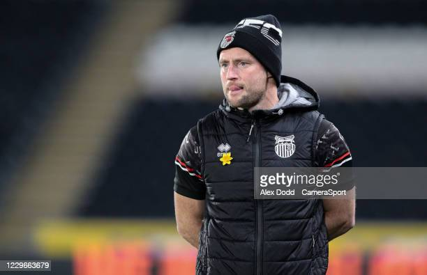 Grimsby Town's first team coach Ben Davies watches on during the EFL Papa John's Trophy Northern Group H match between Hull City and Grimsby Town at...