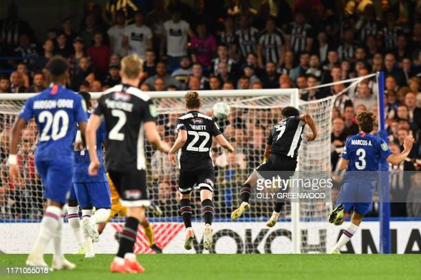 Grimsby Town's Matt Green scores his team's first goal during the English League Cup third round football match between Chelsea and Grimsby Town at...