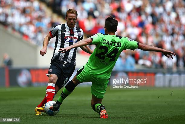 Grimsby's Craig Disley looks to get past the incoming tackle from Forest Green's Darren Carter during the Vanarama Football Conference League Play...