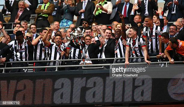 Grimsby's manager Paul Hurst lifts the trophy as he celebrates the teams win and promotion to the football league during the Vanarama Football...