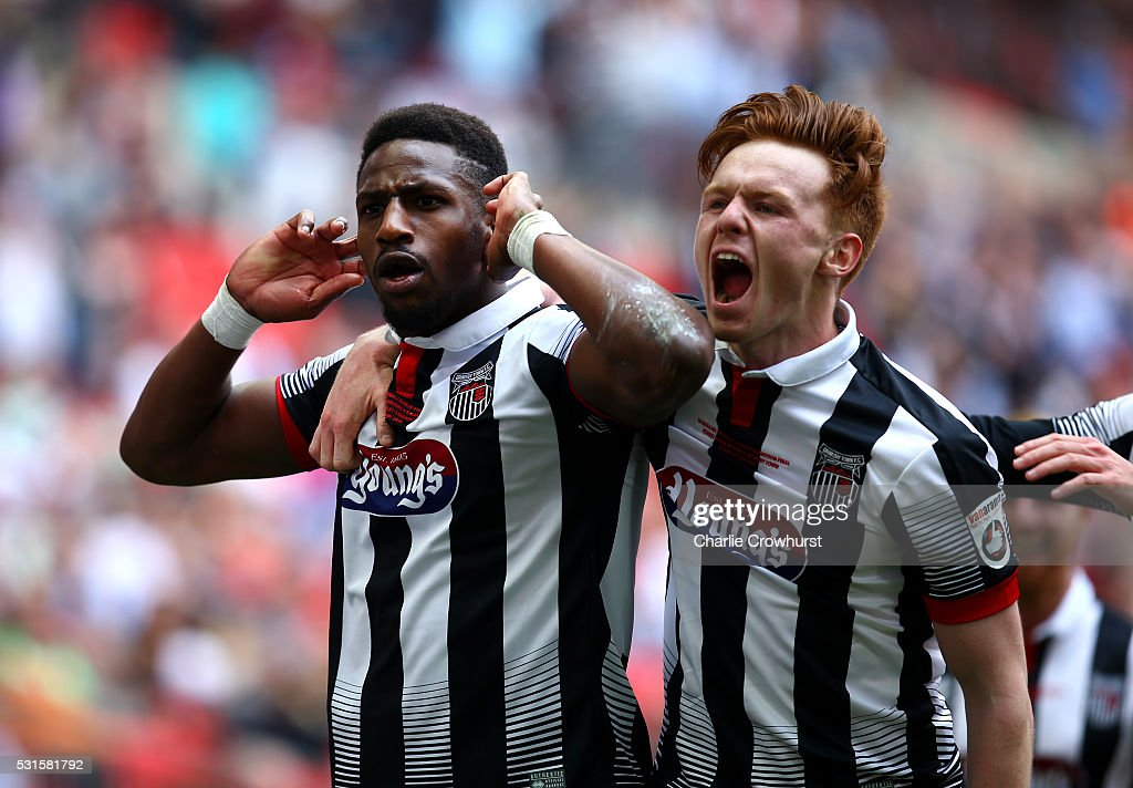 Grimsby's Omar Bogle celebrates with team mate Jon Nolan after scoring his and the teams second goal of the game during the Vanarama Football Conference League Play Off Final between Forest Green Rovers and Grimsby Town at Wembley Stadium on May 15, 2016 in London, England.