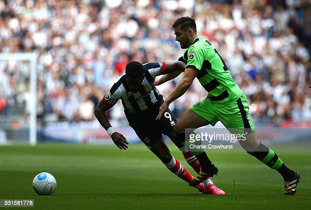 Grimsby's Omar Bogle is pushed off the ball by Forest Green's Aarran Rancine during the Vanarama Football Conference League Play Off Final between...