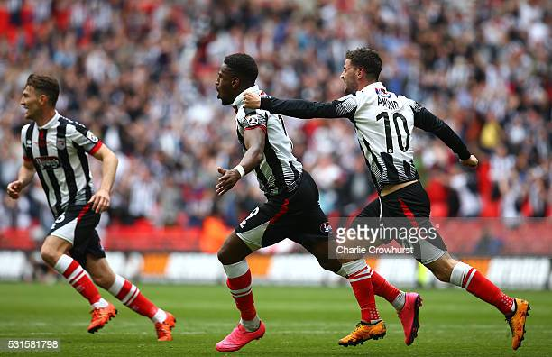 Grimsby's Omar Bogle turn away in celebration after scoring the first goal of the game during the Vanarama Football Conference League Play Off Final...