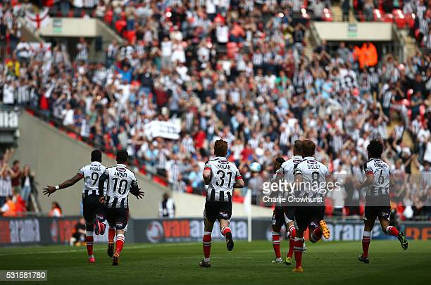 Grimsby's Omar Bogle turns away in celebration after scoring the first goal of the game during the Vanarama Football Conference League Play Off Final...