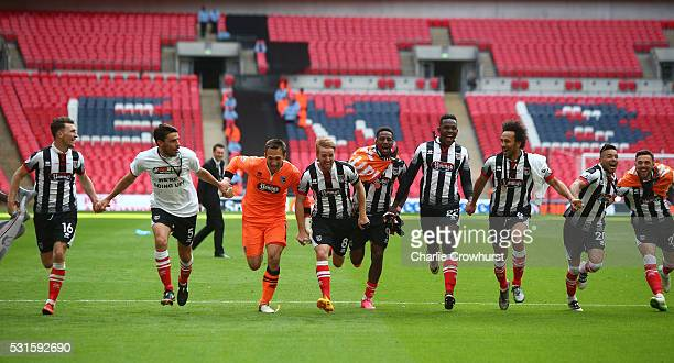 Grimsby's players celebrate the teams win and promotion to the football league during the Vanarama Football Conference League Play Off Final between...