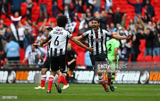 Grimsby's Shaun Pearson and Josh Growling celebrate the teams win and promotion at the final whistle during the Vanarama Football Conference League...