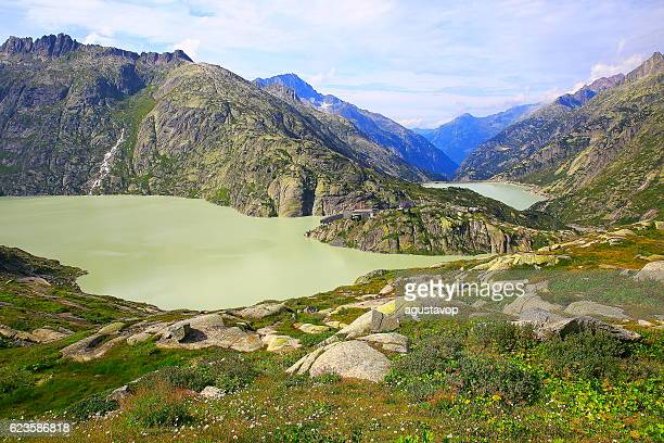 Grimsel pass alpine landscape, glacier lake reservoir, swiss alps