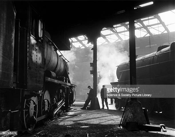 Grimy 8F and Class 5 steam locomotives in a run down shed 1960s Photograph by Bishop Eric Treacy Treacy was often allowed special access to many...