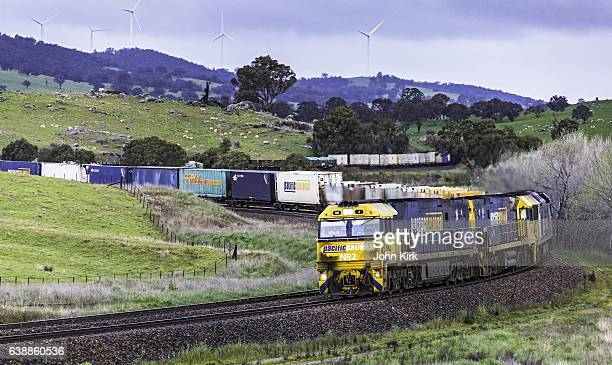 Grimy diesel train locomotives, contrast with clean wind power