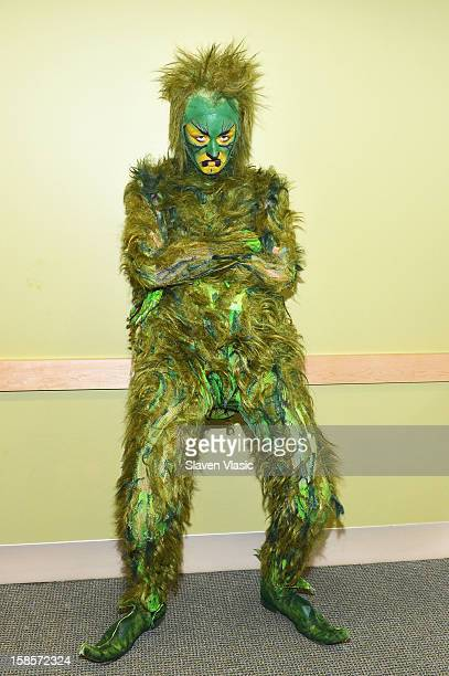 Grinch from MSG's 'How The Grinch Stole Christmas' visits NYU Langone Medical Center to deliver gifts to children from Garden of Dreams Foundation at...