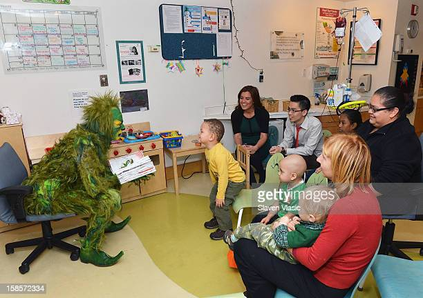 Grinch from MSG's How The Grinch Stole Christmas visits NYU Langone Medical Center to deliver gifts to children from Garden of Dreams Foundation at...